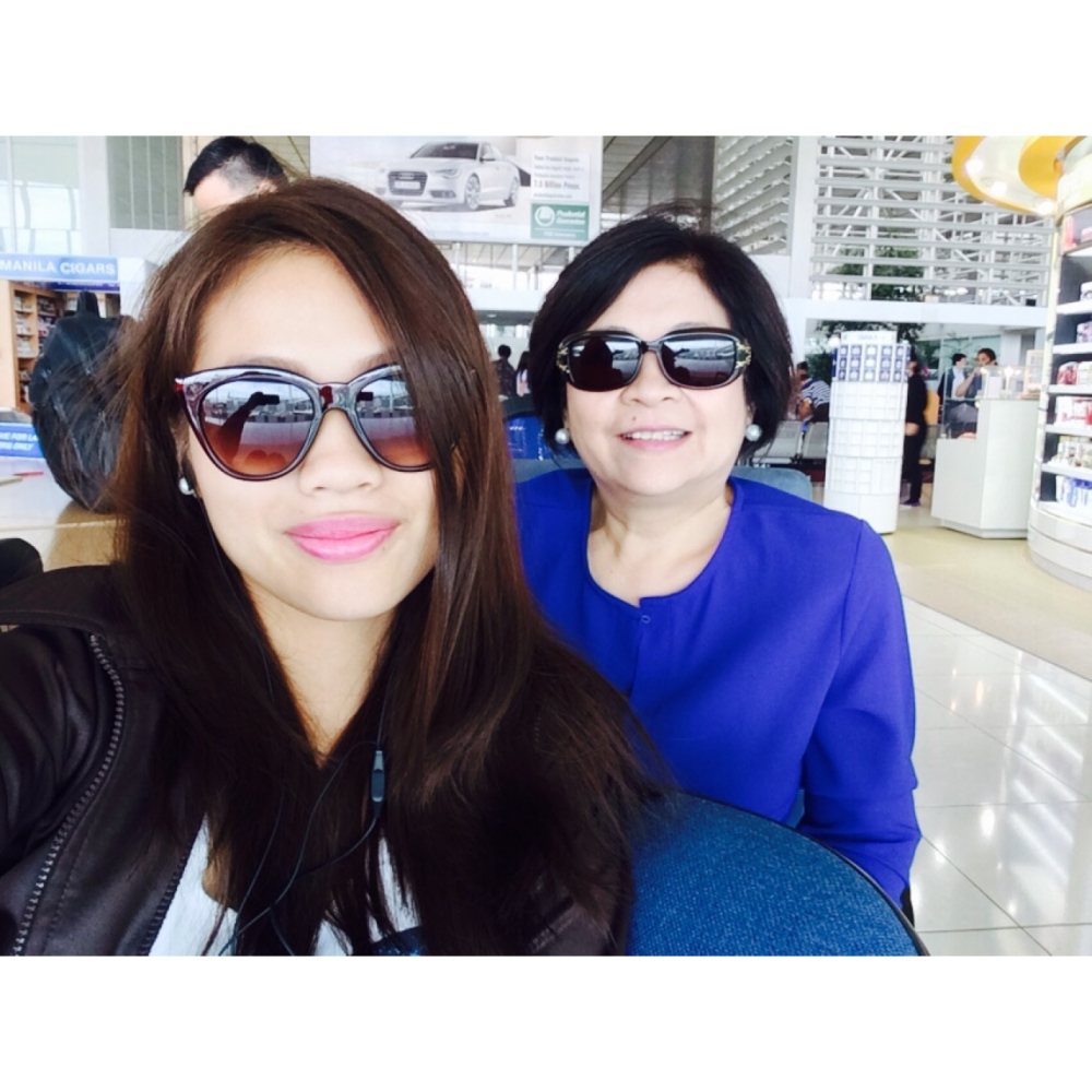 My mom and I waiting for our flight