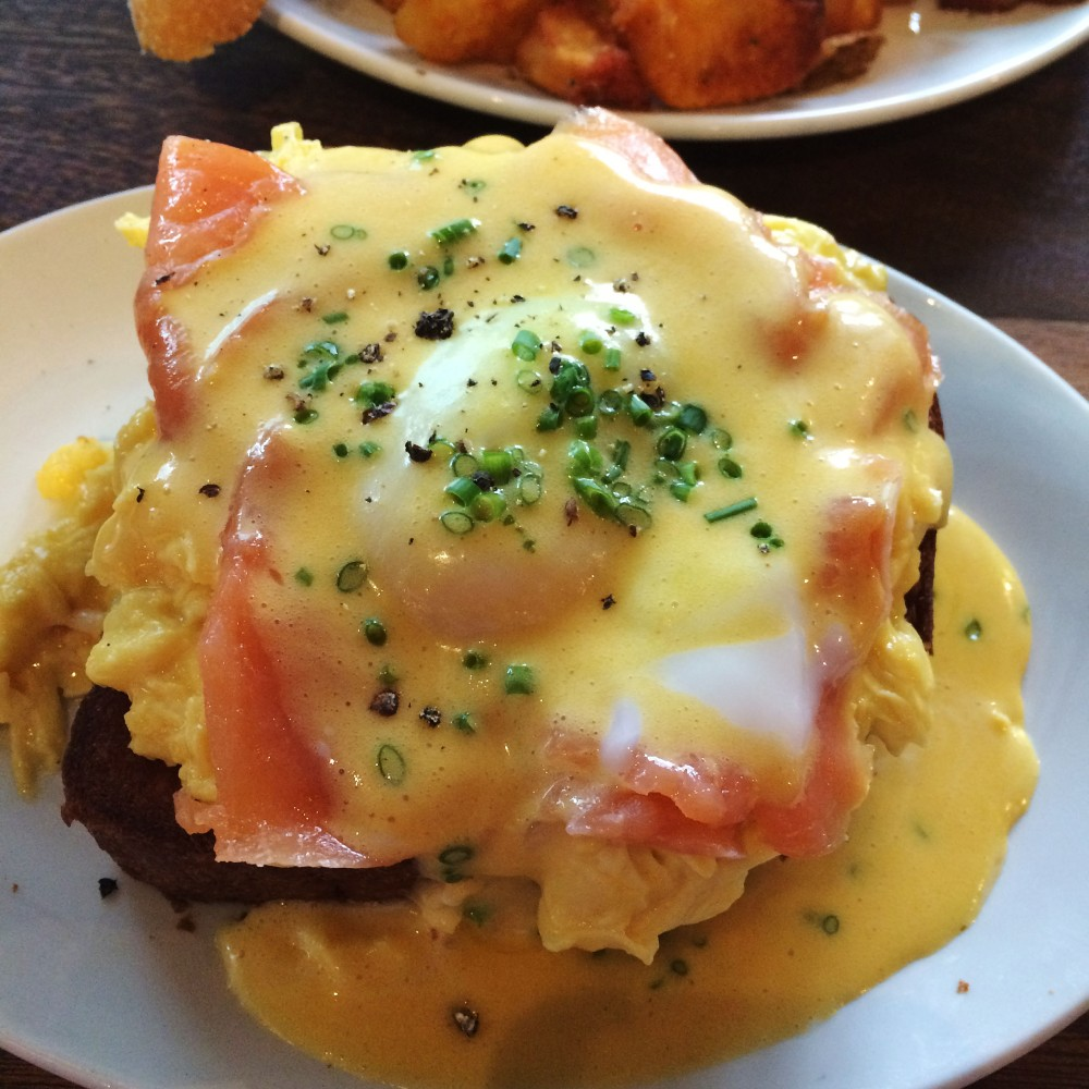 Eggs on toast with smoked salmon, poached eggs, and béarnaise. P350