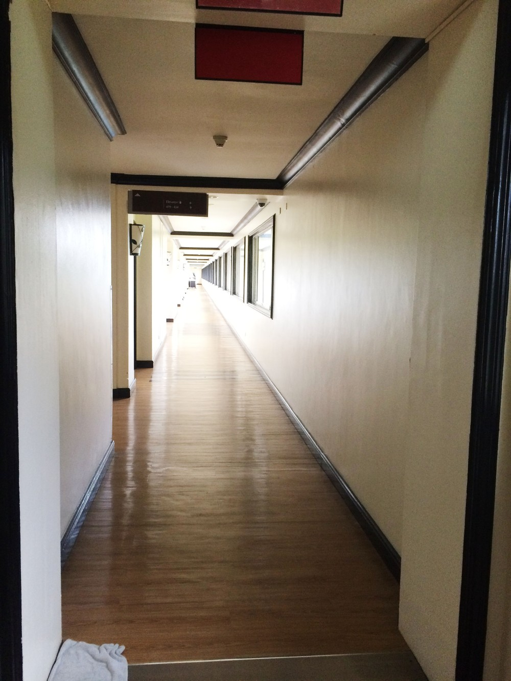 The rooms were located in a different building. The corridor looked scary and old.